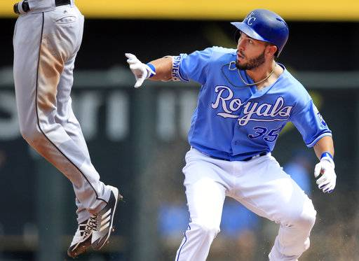 Kansas City Royals' Eric Hosmer (35) protects himself from a jumping Chicago White Sox shortstop Tim Anderson during the sixth inning of a baseball game at Kauffman Stadium in Kansas City, Mo., Tuesday, Sept. 12, 2017. Hosmer doubled on the play. Anderson was catching a high throw from the outfield. (AP Photo/Orlin Wagner)