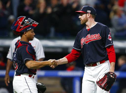 Cleveland Indians relief pitcher Zach McAllister, right, and Francisco Mejia celebrate a 11-0 victory over the Detroit Tigers in a baseball game, Monday, Sept. 11, 2017, in Cleveland. (AP Photo/Ron Schwane)