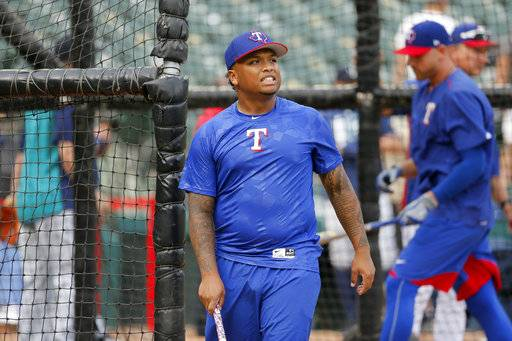 Texas Rangers' Willie Calhoun participates in batting practice before the team's baseball game against the Seattle Mariners on Tuesday, Sept. 12, 2017, in Arlington, Texas. Calhoun, the prized prospect the Rangers got in the Yu Darvish trade, is set for his major league debut. (AP Photo/Tony Gutierrez)