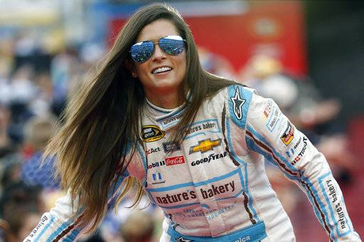 "FILE - In this July 2, 2016, file photo, Danica Patrick greets fans during driver introductions before the start of the NASCAR Sprint Cup auto race at Daytona International Speedway, in Daytona Beach, Fla. Danica Patrick is done at Stewart-Haas Racing and her future in NASCAR is now up in the air amid a sponsorship shake-up. Patrick posted a statement on her Facebook page Tuesday, Sept. 12, 2017 saying her time with Stewart-Haas ""had come to an end� due to a new sponsorship arrangement for the team next season. (AP Photo/Wilfredo Lee, File)"