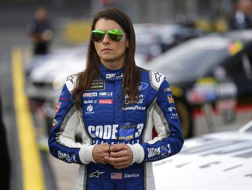 "FILE - In this Thursday, May 25, 2017 file photo, Danica Patrick stands by her car before qualifying for Sunday's NASCAR Cup series auto race at Charlotte Motor Speedway in Concord, N.C. Danica Patrick is done at Stewart-Haas Racing and her future in NASCAR is now up in the air amid a sponsorship shake-up. Patrick posted a statement on her Facebook page Tuesday, Sept. 12, 2017 saying her time with Stewart-Haas ""had come to an end� due to a new sponsorship arrangement for the team next season."