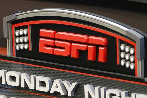 "FILE - This Sept. 16, 2013, file photo shows the ESPN logo prior to an NFL football game between the Cincinnati Bengals and the Pittsburgh Steelers, in Cincinnati. ESPN sideline reporter Sergio Dipp became an unlikely star of ""Monday Night Football� thanks to an awkward debut on the broadcast during the Denver Broncos-Los Angeles Chargers game on Sept. 11, 2017."
