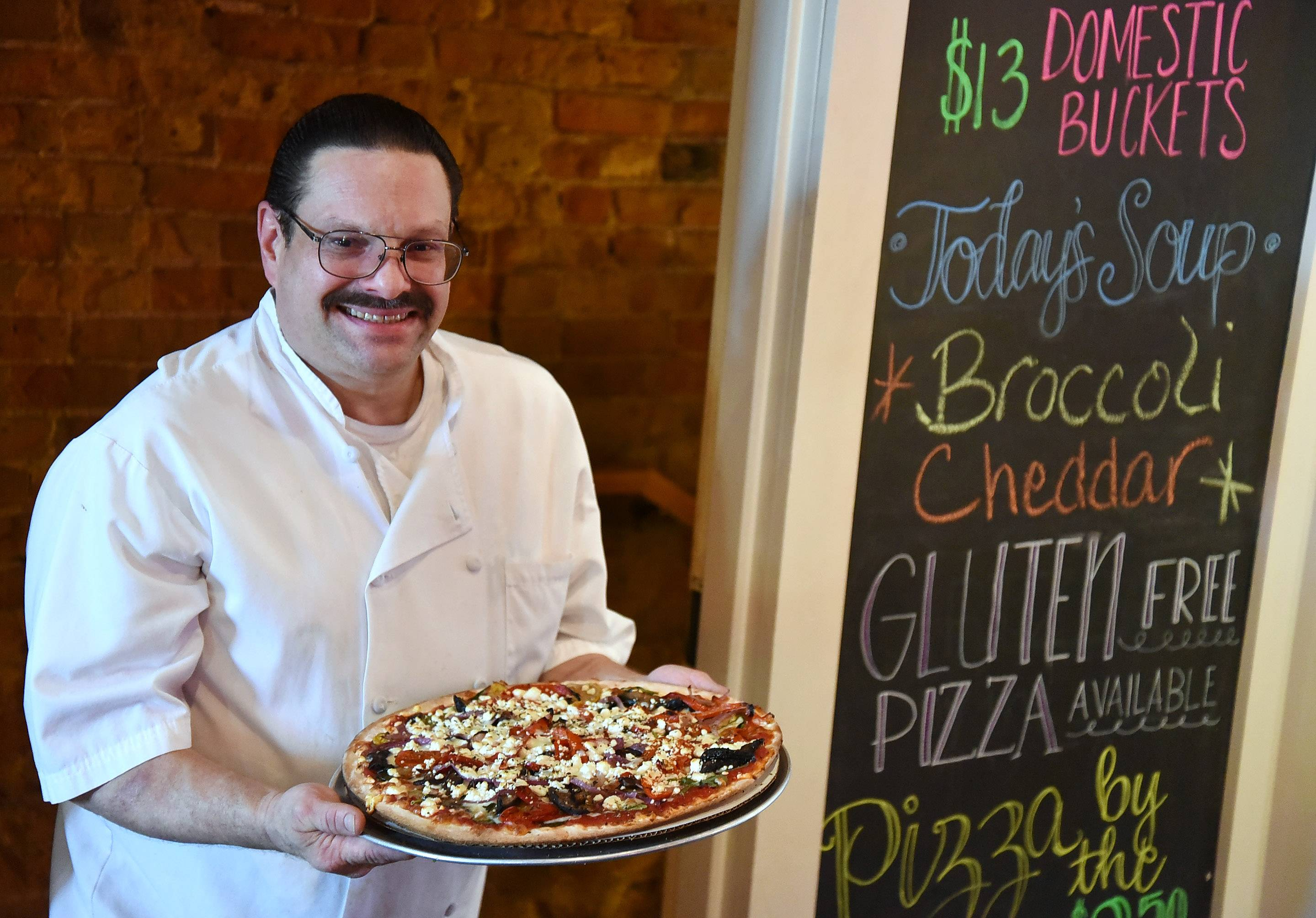 Chef Ed Beekil shows off the roasted veggie pizza at Remember Charlotte's in Barrington.
