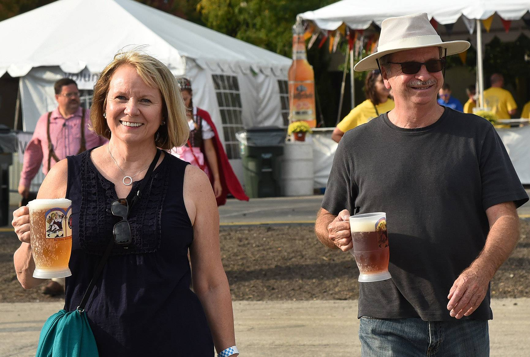 Rick and Diane Gylling of Palatine enjoy some of the first beer poured at the start of last year's Rotary Club of Palatine Oktoberfest.