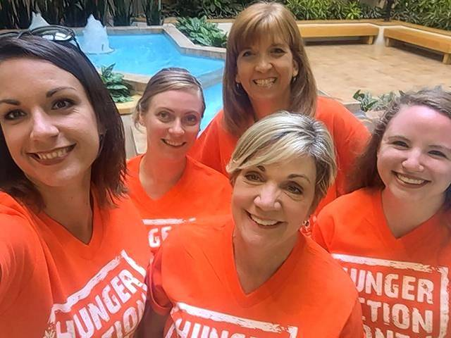 "Daily Herald co-workers Lori Urbaniec, left, Kat Polomsky, Eileen Brown, Karyn Kraske and Kaelyn Jones are ready for National ""Go Orange Day"" Thursday, Sept. 14, as part of Hunger Awareness Month."