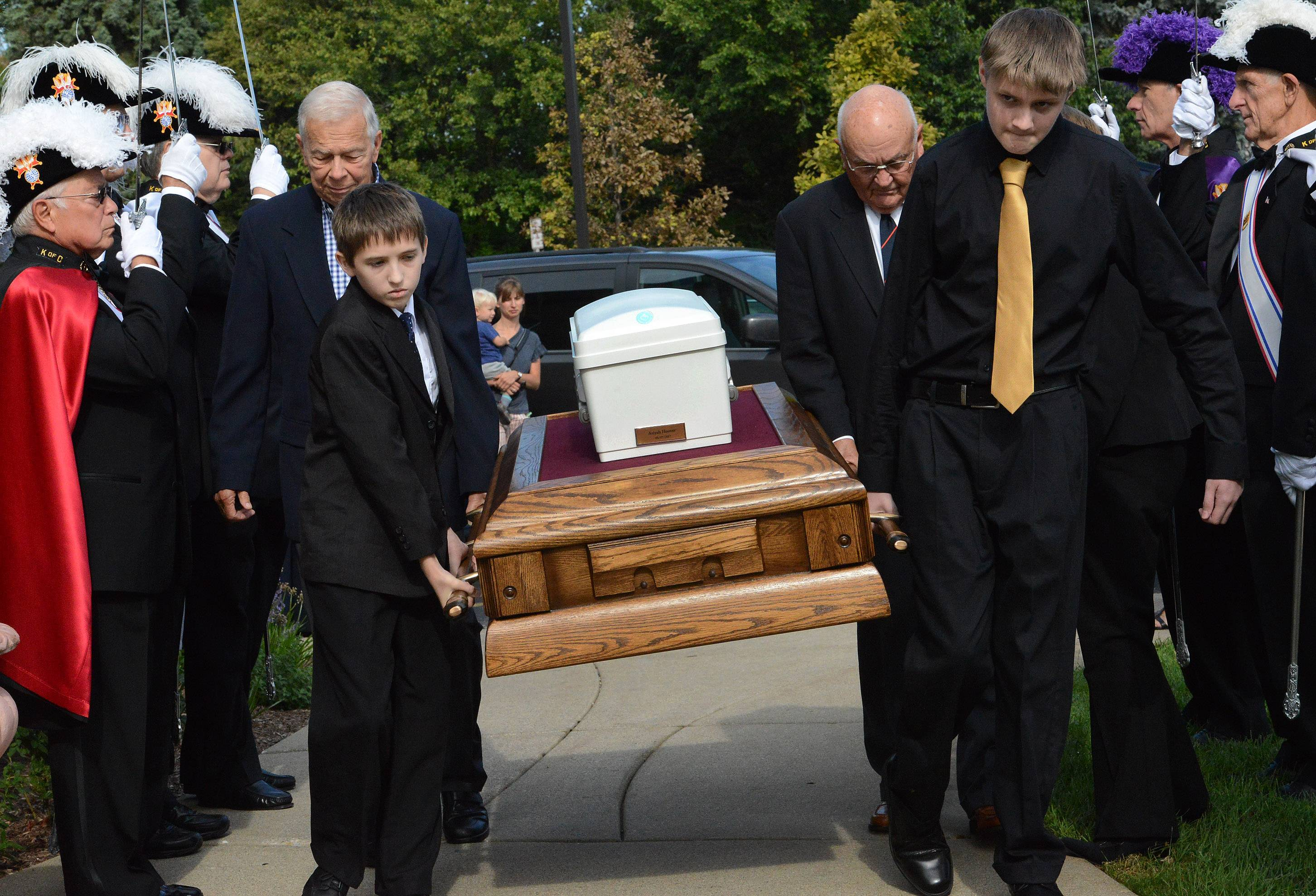 The casket of Ariyah Mikayla Hoover is carried into St. Mary Church in Buffalo Grove by Frank, left, and Joey Matusiewicz of Volo before her funeral.
