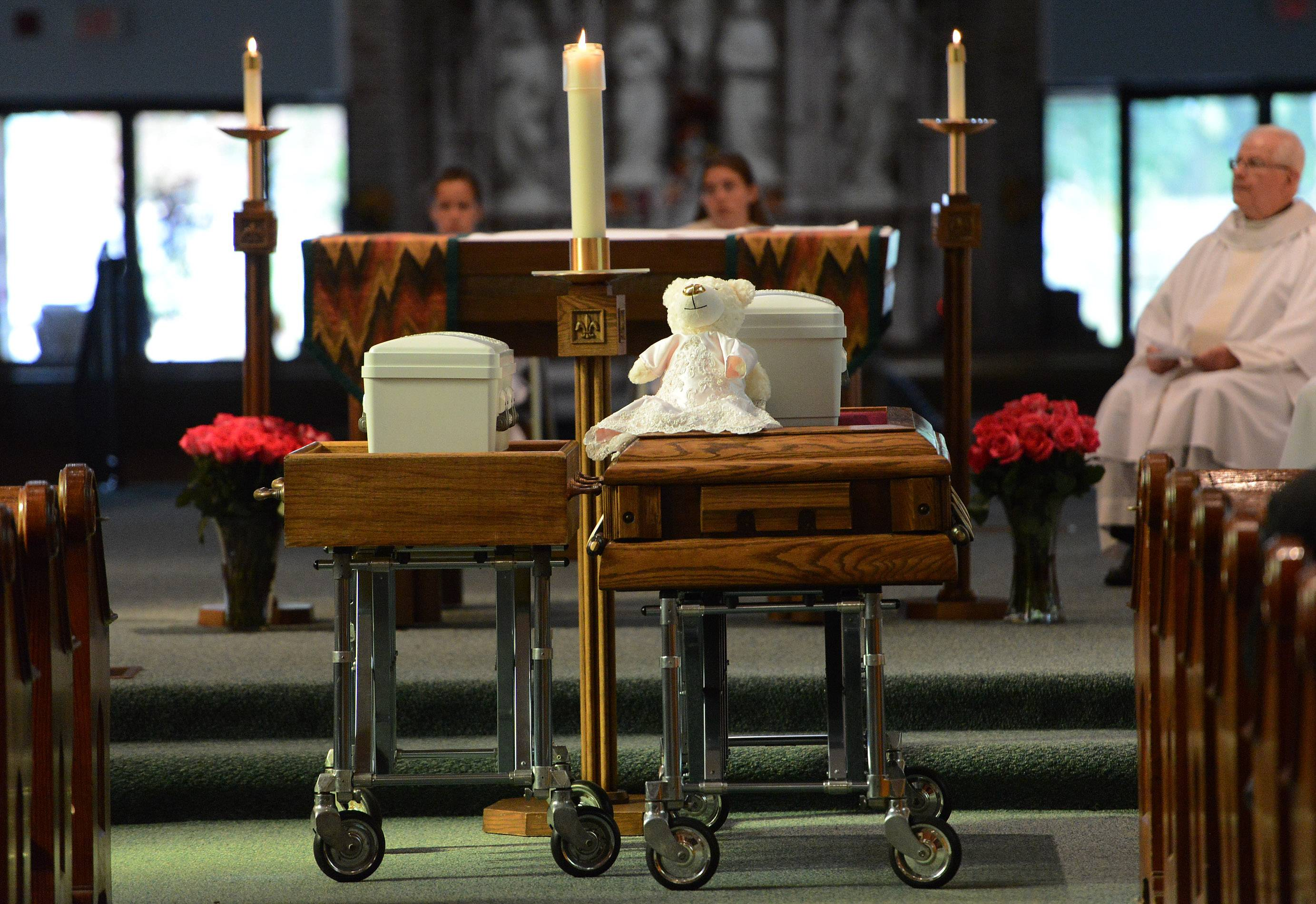 Abandoned babies Mariam Jane Uddin, left, and Ariyah Mikayla Hoover are eulogized during their funeral at St. Mary Church in Buffalo Grove.
