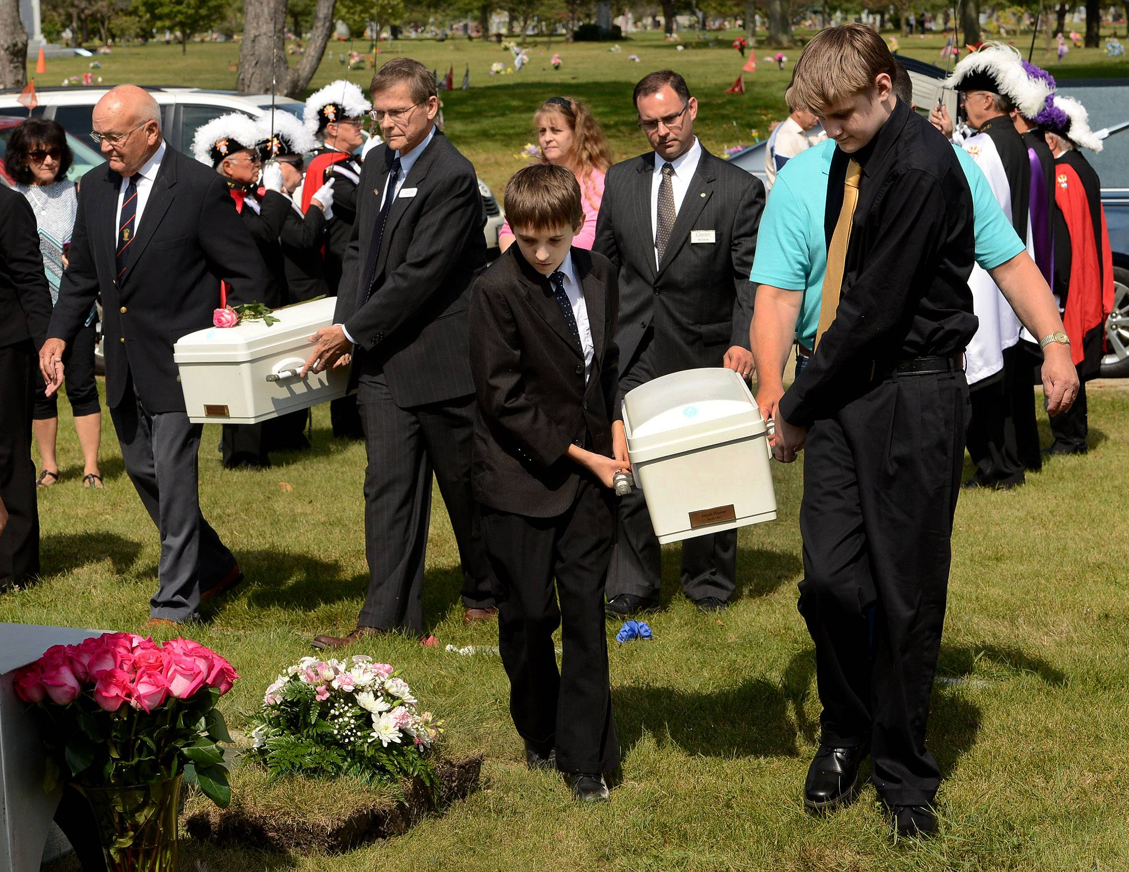 The caskets of babies Mariam Jane Uddin, left, and Ariyah Mikayla Hoover are brought to their gravesites for burial at All Saints Cemetery in Des Plaines. Pallbearers Frank and Joey Matusiewicz of Volo are on the right.