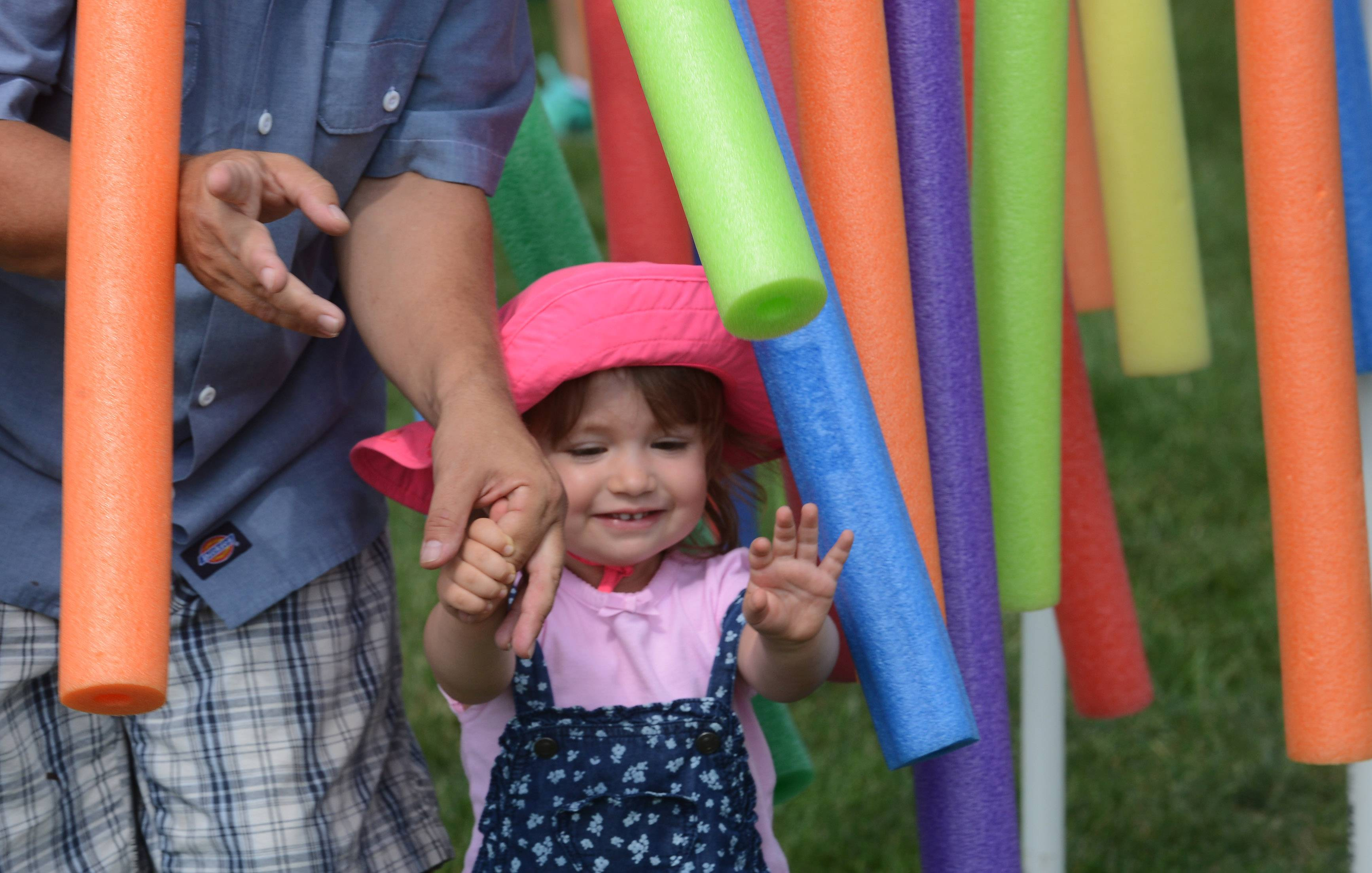 Abbey Fox, 2, of Des Plaines and her dad, Michael, make their way through hanging foam tubes as they have fun at the Des Plaines Fall Fest last year.