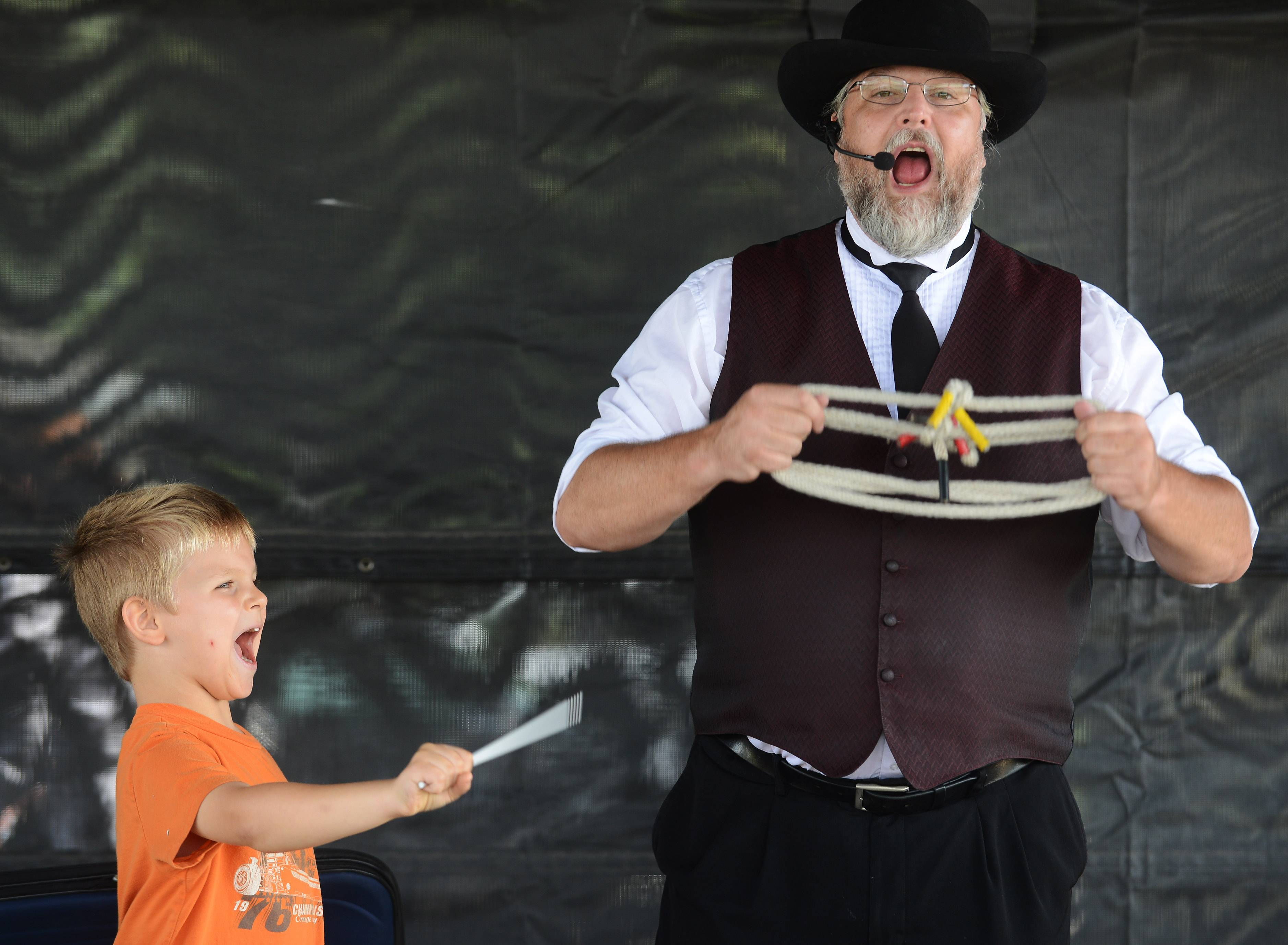 "John Vadopalas, 6, of Des Plaines says the magic word while assisting the ""Magic with Keith"" performance at the 2016 Des Plaines Fall Fest."