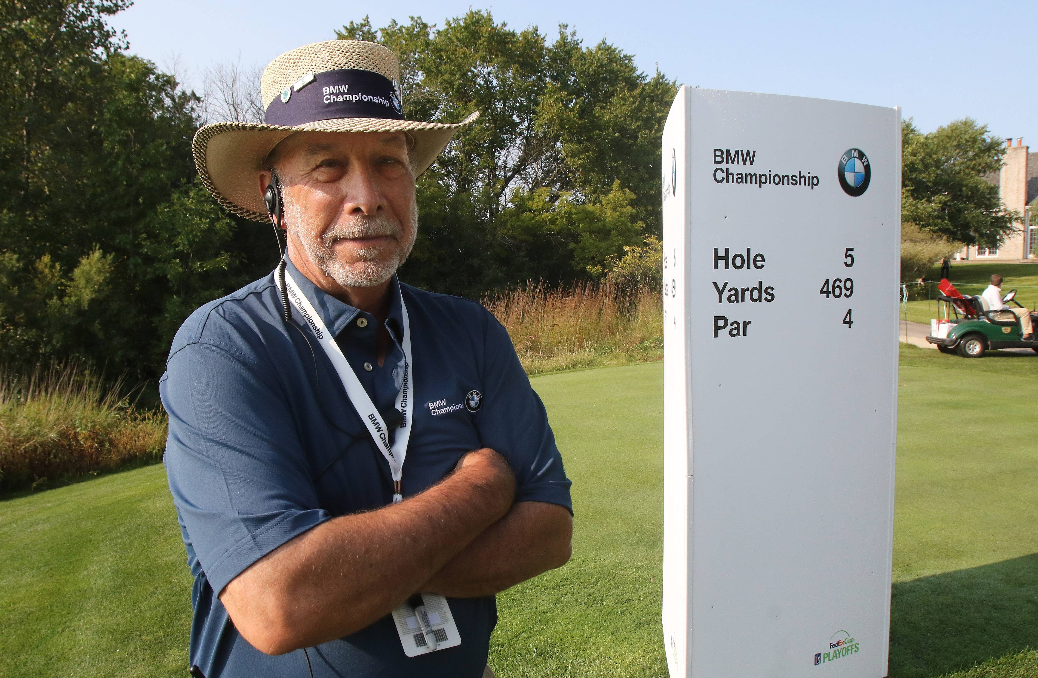 Volunteer Ronald Goldman works as hole captain during Tuesday's practice round for the BMW Championship at Conway Farms Golf Club in Lake Forest. Goldman, of Buffalo Grove, worked two previous BMW tournaments as a hole marshal.