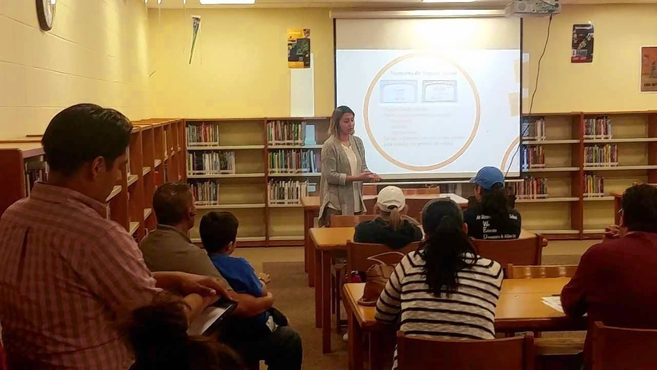 Jael Mejia of Mano a Mano Family Resource Center leads a Spanish-language presentation for Round Lake Area Unit District 116 parents and students at Magee Middle School library Tuesday night on what the end of the Deferred Action for Childhood Arrivals program means for them.