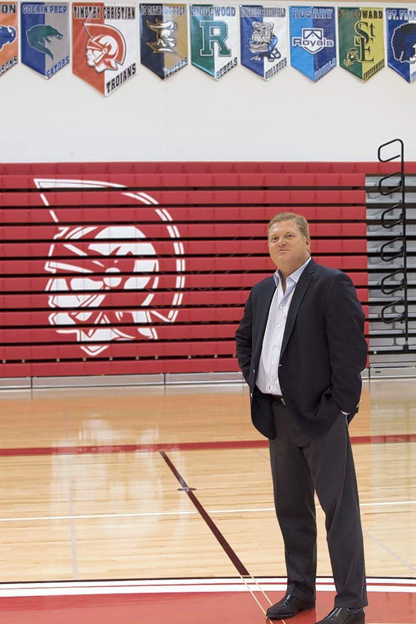Timothy Christian superintendent Matt Davidson stands at midcourt at the new Ward Athletic Center.