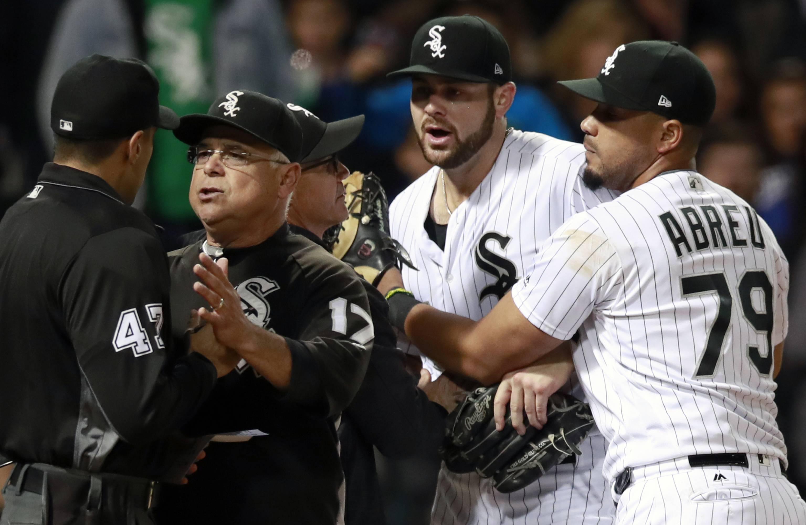 Chicago White Sox manager Rick Renteria (17) argues with umpire Gabe Morales (47) as Jose Abreu (79) holds back starting pitcher Lucas Giolito after Giolito was thrown out of a baseball game by Morales during the sixth inning against the San Francisco Giants in Chicago, Friday, Sept. 8, 2017. (AP Photo/Jeff Haynes)