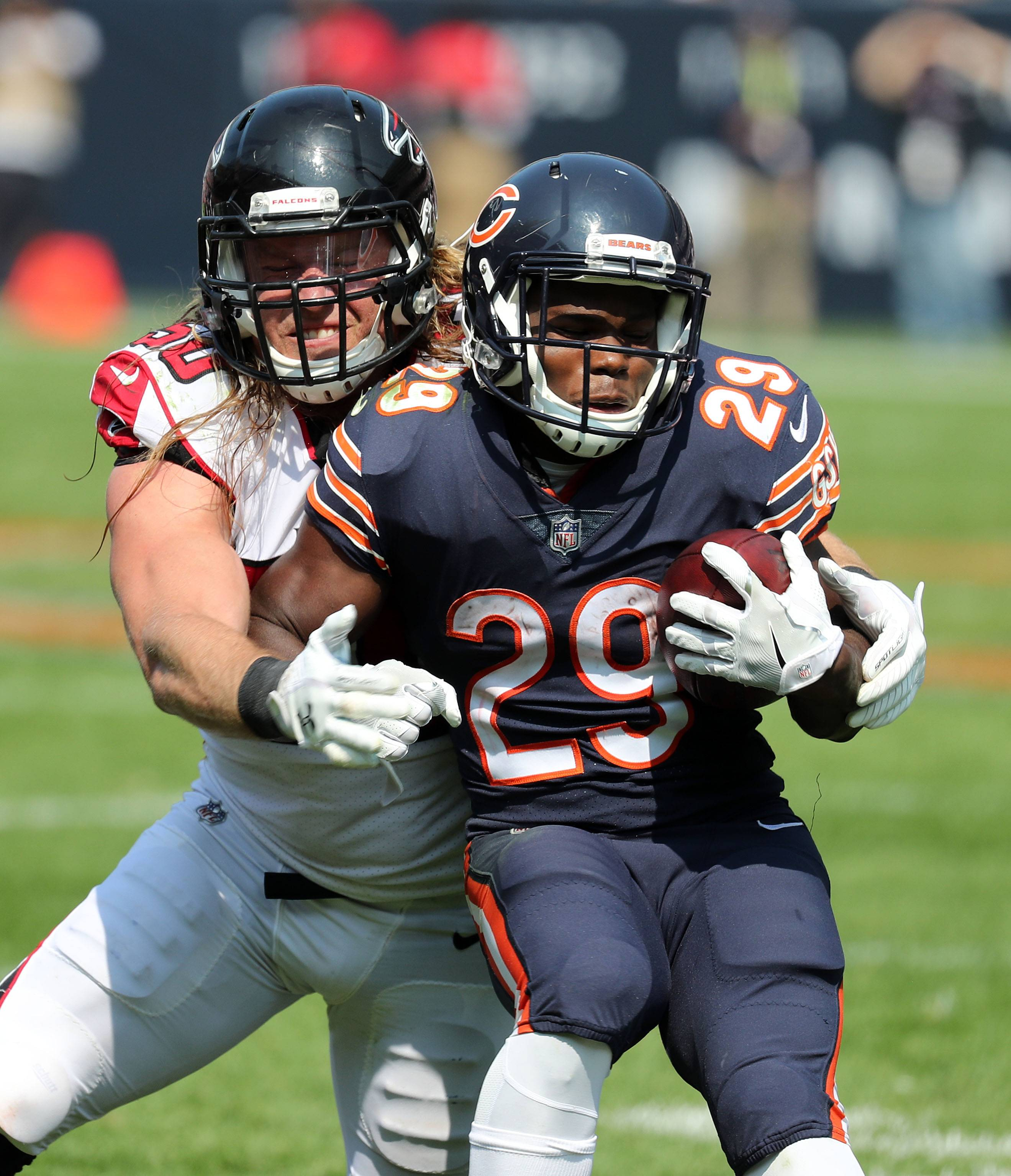 Chicago Bears running back Tarik Cohen is tackled by Atlanta Falcons defensive end Brooks Reed during their game Sunday, Sept. 10, 2017, at Soldier Field on Chicago.