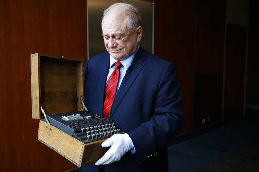 H. Keith Melton holds an Enigma Machine with four rotors and Japanese characters that was used in World War II to encode messages, Wednesday, Sept. 13, 2017, in Washington. The machine is one of the many items that he is donating to the International Spy Museum from his collection of spy objects.