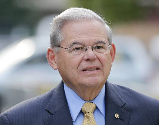 FILE- In this Sept. 6, 2017, file photo, Sen. Bob Menendez arrives to court for his federal corruption trial in Newark, N.J. Menendez, New Jersey's Democratic senior senator, is charged with accepting gifts and campaign donations from Florida ophthalmologist Salomon Melgen over several years in exchange for pressuring government officials to help with Melgen's Medicare dispute, his company's port security contract in the Dominican Republic and the visas.