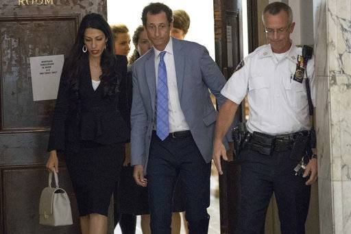 Former congressman Anthony Weiner and his estranged wife, Huma Abedin leave court after appearing before a judge to ask for privacy in their divorce case, Wednesday, Sept. 13, 2017, in New York.  Abedin was a top aide to Democrat Hillary Clinton. She split with Weiner after he repeatedly sent sexually explicit material to other women. Weiner is to be sentenced later this month for sending obscene material to a 15-year-old girl.