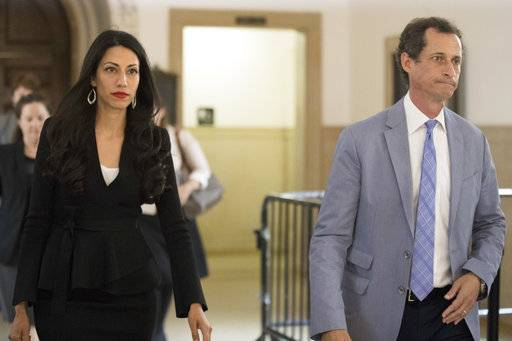 Former congressman Anthony Weiner , right, and his estranged wife, Huma Abedin leave court after appearing before a judge to ask for privacy in their divorce case, Wednesday, Sept. 13, 2017, in New York.  Abedin was a top aide to Democrat Hillary Clinton and split with Weiner after he repeatedly sent sexually explicit material to other women. Weiner is to be sentenced later this month for sending obscene material to a 15-year-old girl.