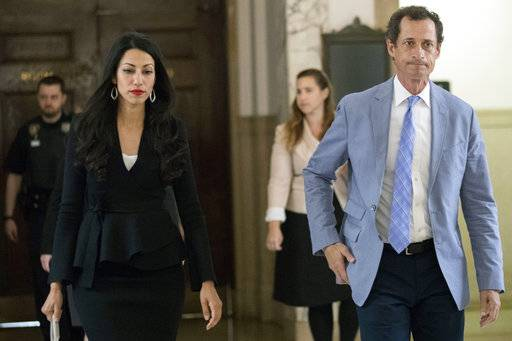 Former U.S. Rep. Anthony Weiner, right, and his estranged wife Huma Abedin leave court, Wednesday, Sept. 13, 2017, in New York. The couple appeared before a New York City judge to ask for privacy in their divorce case.