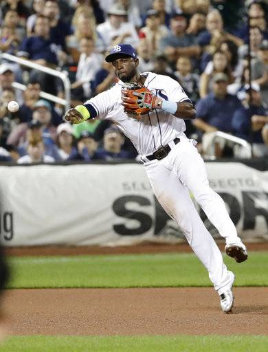 Tampa Bay Rays shortstop Adeiny Hechavarria throws out New York Yankees' Gary Sanchez at first base during the ninth inning of a baseball game Tuesday, Sept. 12, 2017, in New York. The Rays won 2-1. (AP Photo/Frank Franklin II)