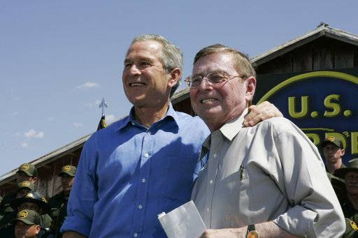 FILE - In this June 6, 2006, file photo, President George W. Bush stands with Sen. Pete Domenici, R-N.M., before speaking about border security and immigration reform at the Federal Law Enforcement Training Center in Artesia, N.M. Domenici, who became a power broker in the Senate for his work on the federal budget and energy policy, has died. He was 85. Domenici died Wednesday, Sept. 13, 2017, at the University of New Mexico Hospital in Albuquerque, Pete Domenici Jr., said.