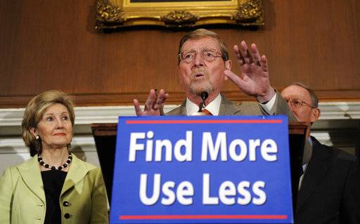 FILE - In this Tuesday, July 29, 2008, file photo,Senate Energy and Natural Resources Committee ranking Republican member Sen. Pete Domenici, R-N.M., center, speaks during a news conference on energy, on Capitol Hill in Washington, accompanied by Sen. Kay Bailey Hutchison, R-Texas., right, and Sen. Lamar Alexander, R-Tenn. Domenici, who became a power broker in the Senate for his work on the federal budget and energy policy, has died. He was 85. Domenici died Wednesday, Sept. 13, 2017, at the University of New Mexico Hospital in Albuquerque, Pete Domenici Jr., said.