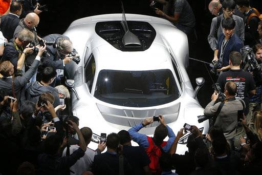 Visitors surround the Mercedes-AMG Project One hyper car during the first media day of the International Frankfurt Motor Show IAA in Frankfurt, Germany, Tuesday, Sept. 12, 2017, which runs through Sept. 24, 2017. From frighteningly fast hypercars to new electric SUVs, the Frankfurt auto show is a major event for car lovers wanting to get a glimpse of the future.