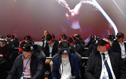 Visitor use VR goggles to see a presentation of Seat at the Volkswagen stand on the first media day of the International Frankfurt Motor Show IAA in Frankfurt, Germany, Tuesday, Sept. 12, 2017, which runs through Sept. 24, 2017. From frighteningly fast hypercars to new electric SUVs, the Frankfurt auto show is a major event for car lovers wanting to get a glimpse of the future.