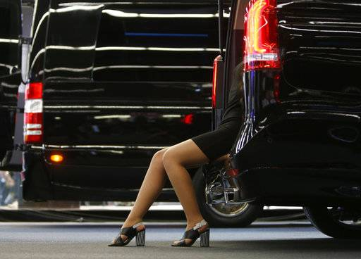 A model sits in the back of a Mercedes van on the first media day of the International Frankfurt Motor Show IAA in Frankfurt, Germany, Tuesday, Sept. 12, 2017, which runs through Sept. 24, 2017. From frighteningly fast hypercars to new electric SUVs, the Frankfurt auto show is a major event for car lovers wanting to get a glimpse of the future.
