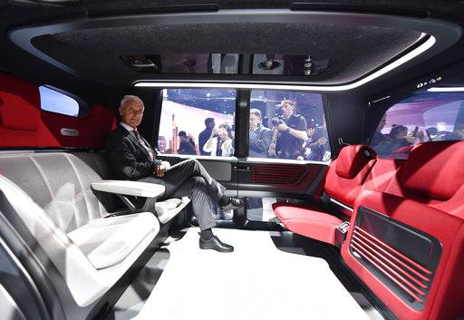 VW CEO Matthias Mueller sits in a Sedric self-driving vehicle during an event of German car maker Volkswagen on the eve of the opening of the International Frankfurt Motor Show IAA in Frankfurt, Germany, Monday, Sept. 11, 2017. From frighteningly fast hypercars to new electric SUVs, the Frankfurt auto show is a major event for car lovers wanting to get a glimpse of the future.