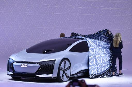 An Audi Aicon concept car is unveiled on the stand of Volkswagen during the first media day of the International Frankfurt Motor Show IAA in Frankfurt, Germany, Tuesday, Sept. 12, 2017, which runs through Sept. 24, 2017. From frighteningly fast hypercars to new electric SUVs, the Frankfurt auto show is a major event for car lovers wanting to get a glimpse of the future.