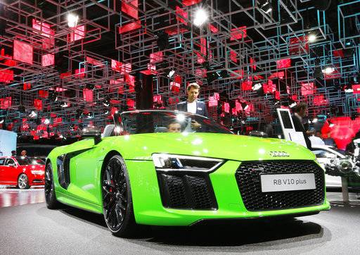 Two men take a closer look at a Audi R8 V10 plus on the second media day of the IAA Motor Show in Frankfurt, Germany, Wednesday, Sept. 13, 2017. From frighteningly fast hypercars to new electric SUVs, the Frankfurt auto show is a major event for car lovers wanting to get a glimpse of the future.