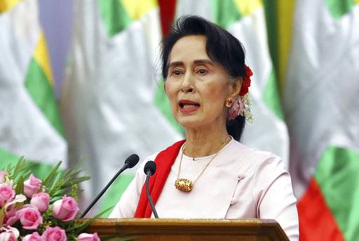 FILE - In this Friday, Aug. 11, 2017, file photo, Myanmar's State Counsellor Aung San Suu Kyi delivers an opening speech during the Forum on Myanmar Democratic Transition in Naypyitaw, Myanmar. Suu Kyi has canceled plans to attend the U.N. General Assembly, with her country drawing international criticism for violence that has driven at least 370,000 ethnic Rohingya Muslims from the country in less than three weeks.