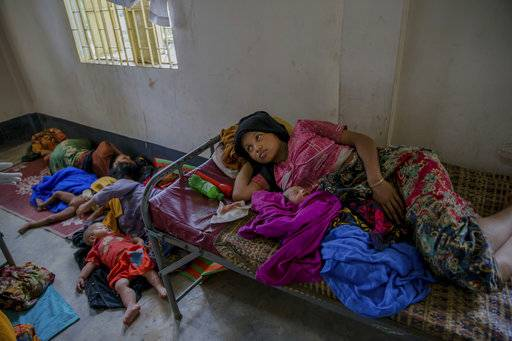Newly arrived Rohingya women along with their children rest inside a health complex run by aid agencies in Kutupalong refugee camp, Bangladesh, Wednesday, Sept. 13, 2017. With Rohingya refugees still flooding across the border from Myanmar, those packed into camps and makeshift settlements in Bangladesh were becoming desperate for scant basic resources as hunger and illness soared.