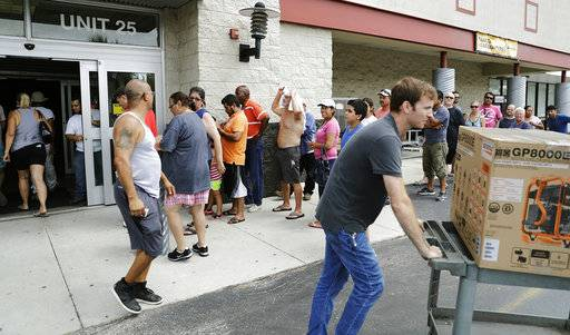 Customers wait in line to buy generators as many residents are still without power three days after Hurricane Irma passed through in Fort Myers, Fla., Wednesday, Sept. 13, 2017.