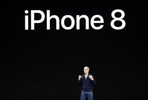 Apple CEO Tim Cook, discusses the new iPhone 8 at the Steve Jobs Theater on the new Apple campus on Tuesday, Sept. 12, 2017, in Cupertino, Calif.