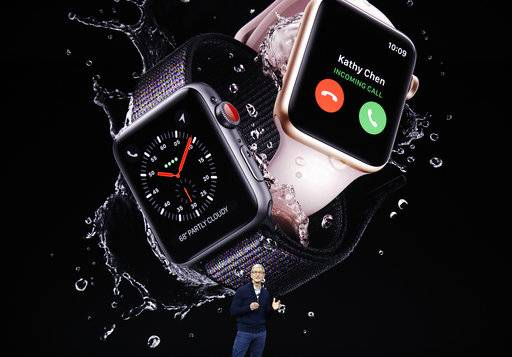 Apple CEO Tim Cook shows new Apple Watch Series 3 products at the Steve Jobs Theater on the new Apple campus, Tuesday, Sept. 12, 2017, in Cupertino, Calif.