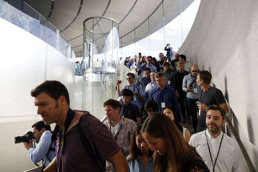 People arrive for a new product announcement at the Steve Jobs Theater on the new Apple campus, Tuesday, Sept. 12, 2017, in Cupertino, Calif.