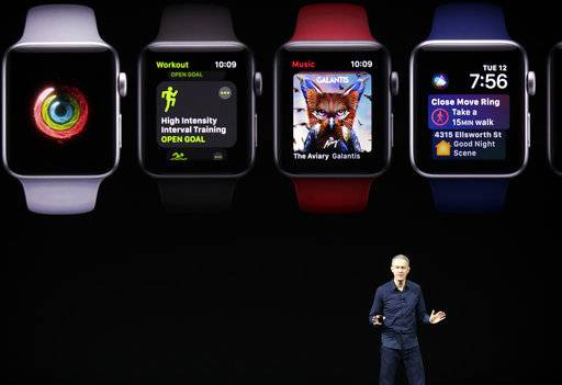 Jeff Williams, Apple's chief operating officer, shows new Apple Watch products at the Steve Jobs Theater on the new Apple campus on Tuesday, Sept. 12, 2017, in Cupertino, Calif.