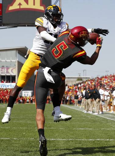 FILE - In this Sept. 9, 2017, file photo, Iowa defensive back Michael Ojemudia breaks up a pass intended for Iowa State wide receiver Allen Lazard (5) during overtime of an NCAA college football game, in Ames, Iowa. North Texas plays at Iowa on Saturday, Sept. 16. The Hawkeyes yielded 41 points and 467 yards in an overtime win over Iowa State last week. Now they face a squad that's amassed 91 points and 1, 161 yards in two games _ albeit against Lamar and SMU _ behind quarterback Mason Fine, who's completed 69 percent of his passes for 648 yards and six TDs. (AP Photo/Charlie Neibergall, File)
