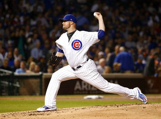 Chicago Cubs starting pitcher Jon Lester delivers during the second inning of the team's baseball game against the New York Mets on Wednesday, Sept. 13, 2017, in Chicago.