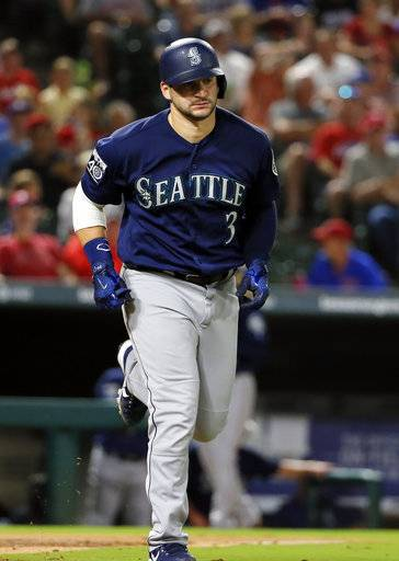 Seattle Mariners' Mike Zunino jogs to first after earning a walk against Texas Rangers starting pitcher Martin Perez in the sixth inning of a baseball game, Wednesday, Sept. 13, 2017, in Arlington, Texas. (AP Photo/Tony Gutierrez)