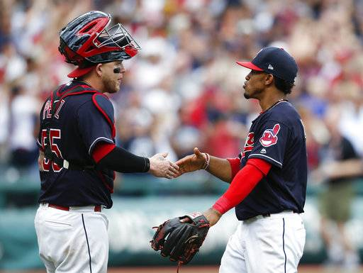 Cleveland Indians' Roberto Perez, left, and Francisco Lindor celebrate a 5-3 victory over the Detroit Tigers in a baseball game, Wednesday, Sept. 13, 2017, in Cleveland. The Indians set the American League record with 21 consecutive wins.