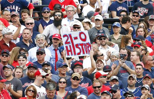 Cleveland Indians fans celebrate a 5-3 victory over the Detroit Tigers in a baseball game, Wednesday, Sept. 13, 2017, in Cleveland. The Indians set the American League record with 21 consecutive wins.