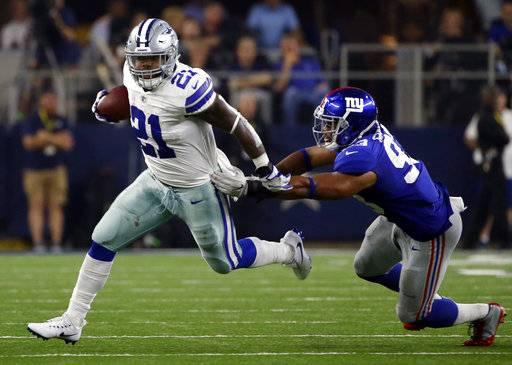 Dallas Cowboys running back Ezekiel Elliott (21) escapes a tackle attempt by New York Giants linebacker B.J. Goodson (93) in the second half of an NFL football game, Sunday, Sept. 10, 2017, in Arlington, Texas. (AP Photo/Ron Jenkins)