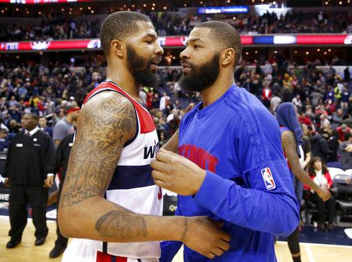 FILE - In this Feb. 19, 2016, file photo, Washington Wizards forward Markieff Morris, left, and Detroit Pistons forward Marcus Morris talk on the court after an NBA basketball game in Washington. A trial will begin for NBA players Marcus and Markieff Morris, who allegedly assaulted a man outside a Phoenix recreation center two years ago. Maricopa County Superior Court officials announced the trial's upcoming jury selection will start Wednesday morning, Sept. 13, 2017. (AP Photo/Alex Brandon, File)