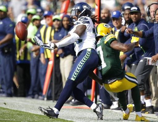 Seattle Seahawks' Shaquill Griffin breaks up a pass intended for Green Bay Packers' Davante Adams during the first half of an NFL football game Sunday, Sept. 10, 2017, in Green Bay, Wis. (AP Photo/Jeffrey Phelps)
