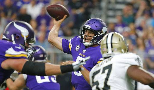 FILE - In this Monday, Sept. 11, 2017, file photo, Minnesota Vikings quarterback Sam Bradford throws a pass during the team's NFL football game against the New Orleans Saints in Minneapolis. For the first time since 2014, Bradford is a captain again. He's also the NFC Offensive Player of the Week, after his stellar performance for Minnesota in the season-opening win against New Orleans. Finally settled with the Vikings after a whirlwind 2016, Bradford is becoming just the leader this team needs. (AP Photo/Bruce Kluckhohn, File)