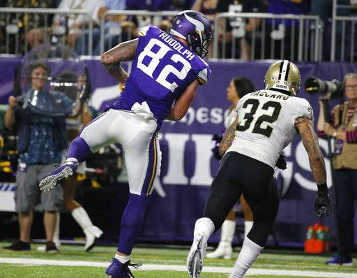 Minnesota Vikings tight end Kyle Rudolph (82) catches a 15-yard touchdown pass in front of New Orleans Saints strong safety Kenny Vaccaro (32) during the second half of an NFL football game, Monday, Sept. 11, 2017, in Minneapolis. (AP Photo/Bruce Kluckhohn)